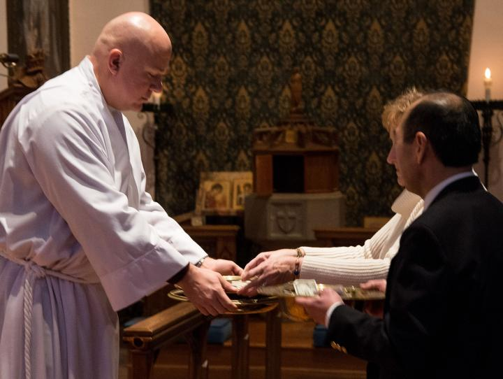 The offering is received at St. George's Church in Maplewood