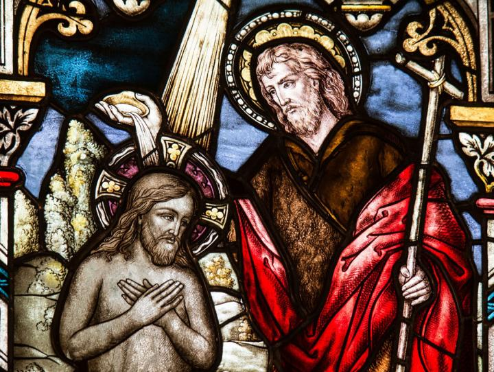 Stained glass window of the Baptism of Our Lord