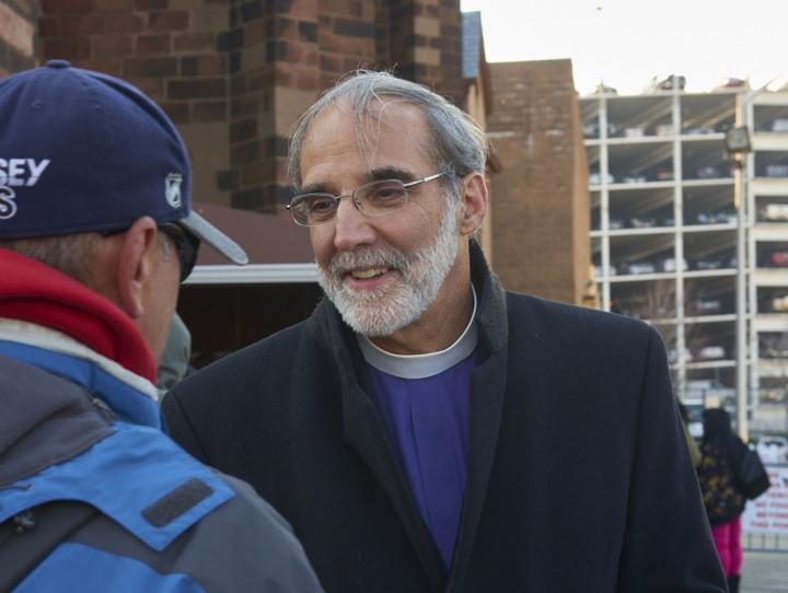 Bishop Beckwith visiting with a Newark soup kitchen client. BRUCE PARKER PHOTO