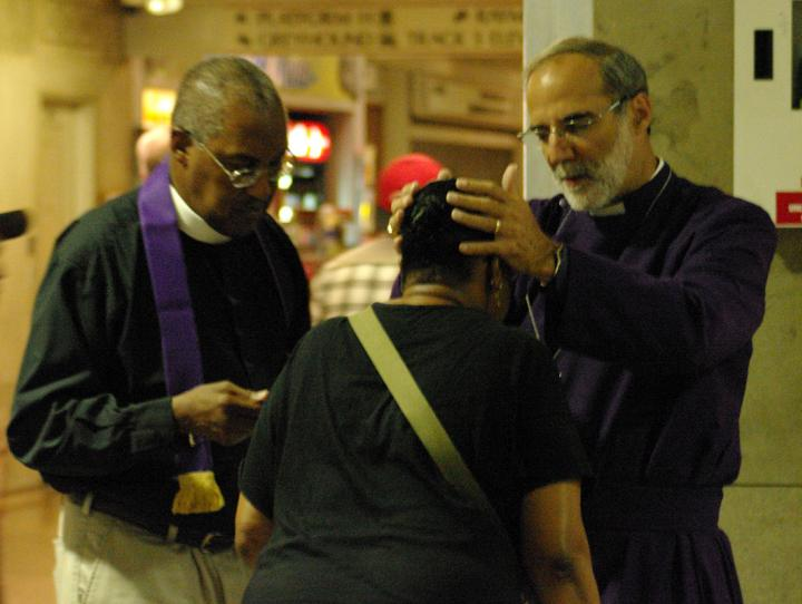 "Bishop Beckwith and Canon Jacobs giving ""Blessings for a Wounded World"""