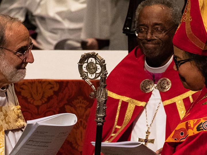 The Rt. Rev. Mark M. Beckwith, 10th Bishop of Newark, passes the diocesan crozier to the Rt. Rev. Carlye J. Hughes, newly-consecrated 11th Bishop of Newark. CYNTHIA L. BLACK PHOTO