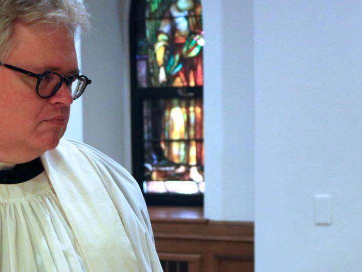Canon Wright and Canon Clark chat after a recent ordination service. NINA NICHOLSON PHOTO