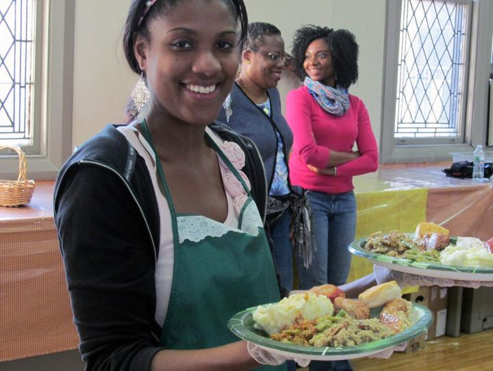 A volunteer serving meals.