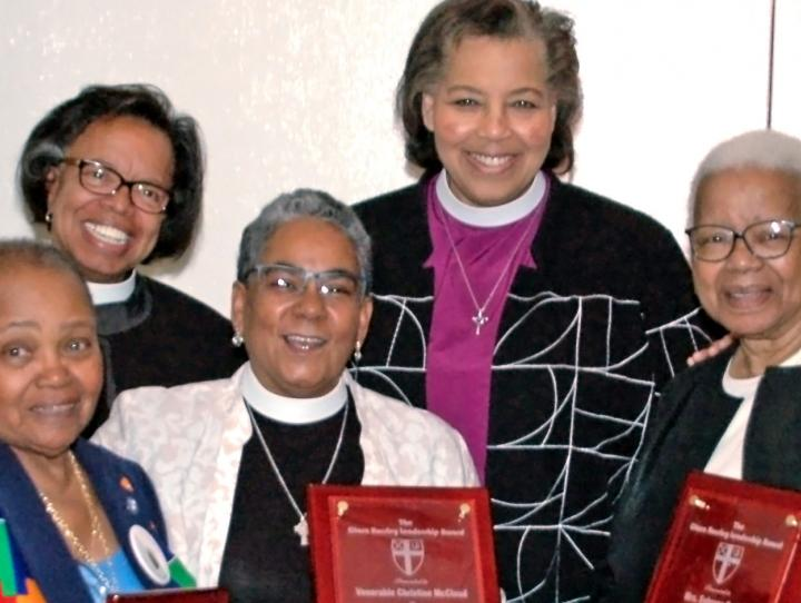 Front row, l-r: Recipients, A. Lorraine Jones, the Ven. Christine McCloud, Sebrena Davis and the Rev. Lynn Collins. Back row, l-r: UBE members, the Rev. Dr. Miguel Hernandez and  the Rev. Dr. Michelle White; Bishop Carlye Hughes; and recipient, the Rev. Canon Gregory A. Jacobs.