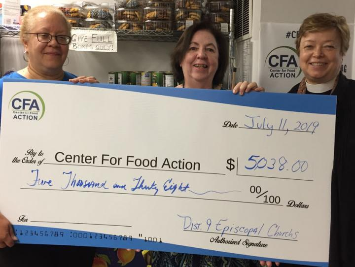 Claudia Smith of St. Luke's, Haworth and co-chair of our 2019 Lenten Offering Committee (left) and the Rev. Lynne Bleich Weber, District 9 Convener (right) present a check to Pat Espy, Executive Director of the Center for Food Action.