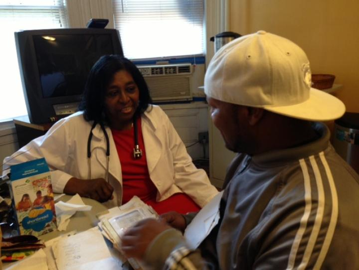 Nurse Martha Tisdale with a guest at Garden State Episcopal CDC's Drop-In Center