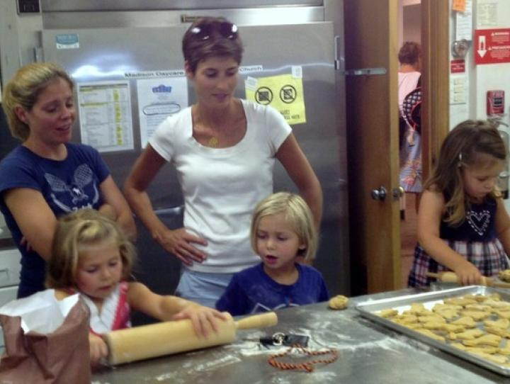 Grace, Madison children rolling out dough for dog biscuits