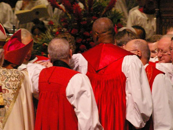Bishops lay hands on the Rt. Rev. Mark Beckwith, 10th Bishop of Newark, at his consecration in January 2007. NINA NICHOLSON PHOTO