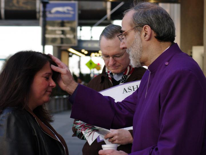 Bishop Mark Beckwith giving Ashes to Go at Newark Penn Station