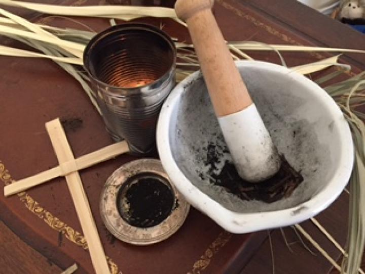 Palms, brazier, and mortal and pestle used to create ashes