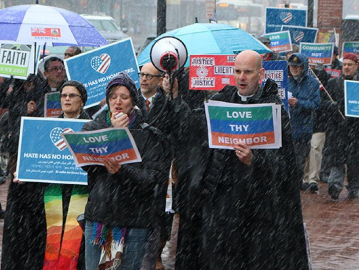 The Rev. Diana Wilcox and the Rev. John Mennell at the front of the march down Broad Street in Newark to the Federal Building, where they joined Senator Bob Menendez and Cardinal Joseph Tobin, Archbishop of Newark for a vigil and press conference supporting Catalino Guerrero during his meeting with federal immigration officials. NINA NICHOLSON PHOTO