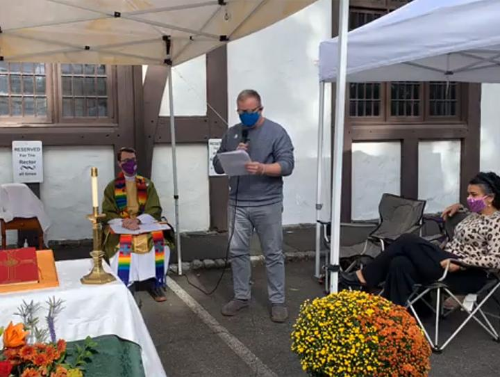 In-person worship at St. George's, Maplewood, held outdoors in the parking lot under canopies.
