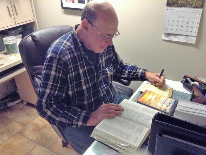 John preparing for Bible study.