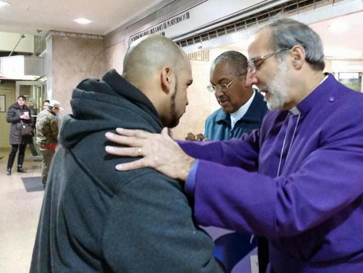 "Bishop Beckwith & Canon Jacobs giving ""Blessings to Go"" in Newark Penn Station"