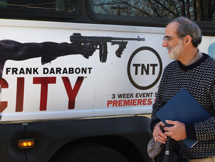 Bishop Mark Beckwith contemplates ad on Newark bus that glorifies gun violence.