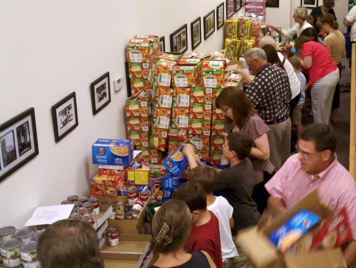 Members of St. James', Hackettstown packing bags of groceries.
