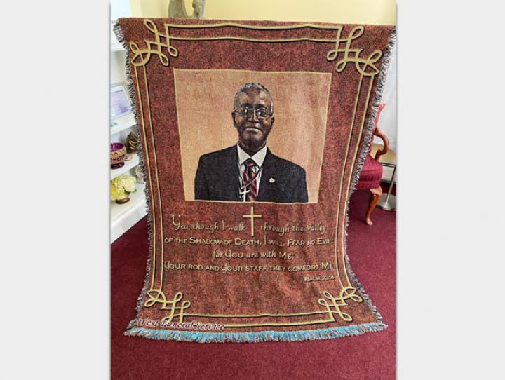 Tapestry honoring the late Sidney King.