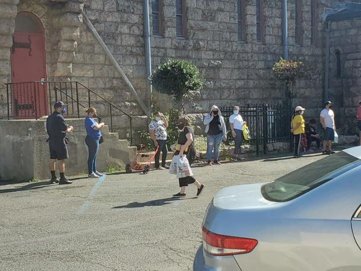 Clients line up outside the food pantry at St. Paul's, Paterson. ERIK SOLDWEDEL PHOTO