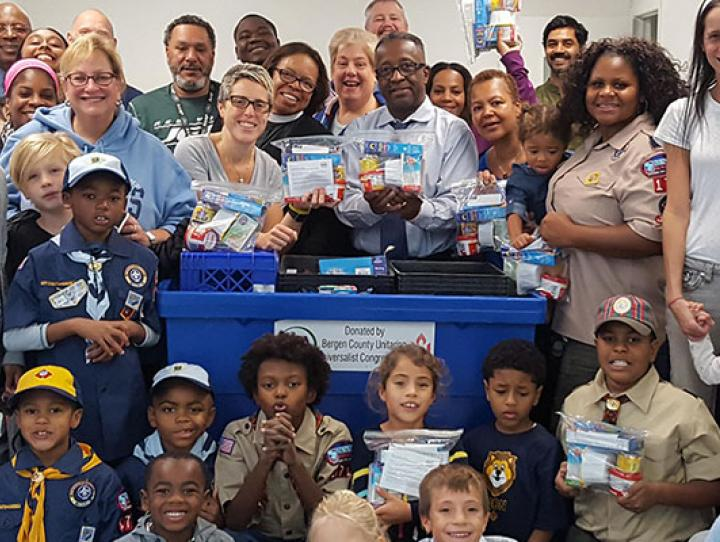 In this photo from the 2017 Mission Minutes, the congregations of Christ Church, Teaneck and St. Paul's Church, Englewood work together to assemble 700 weekend snack packs for local children who face hunger when school meals are not available.
