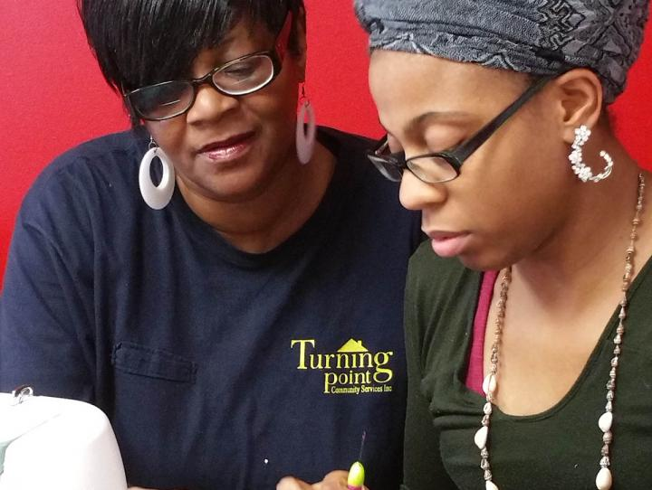 Jeanette teaching sewing in the TPCS, Inc. peer training program.