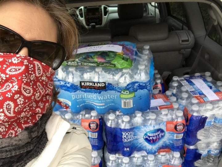 Author Birgitta Karlen with a trunk full of bottled water ready to be delivered to a local hospital.
