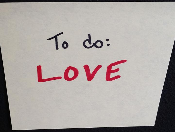 "A post-it reminder upon which is written ""To do: LOVE"""