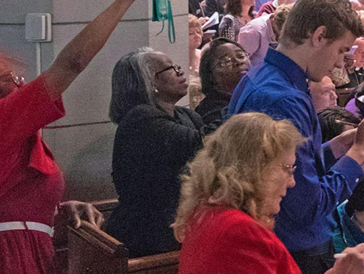 Two youth deputies (front pew in blue shirts) react to the election of the XI Bishop of Newark. CYNTHIA BLACK PHOTO
