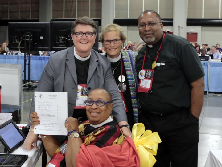 "The four clerical deputies from Newark pose with the ""Vote by Orders"" record"