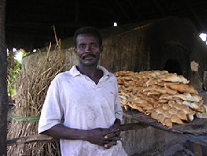 Haitian man baking bread. PHOTO COURTESY ERD