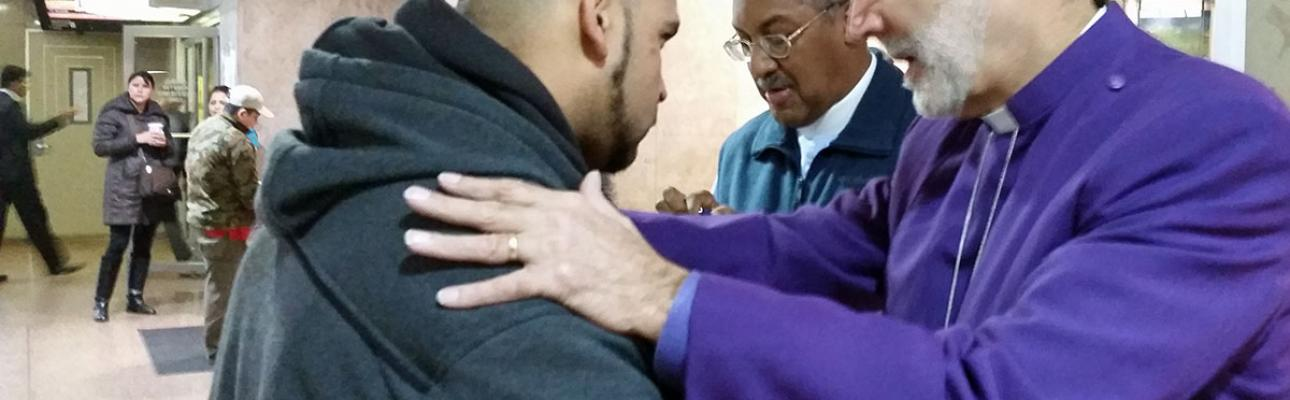 """Bishop Beckwith & Canon Jacobs giving """"Blessings to Go"""" in Newark Penn Station"""