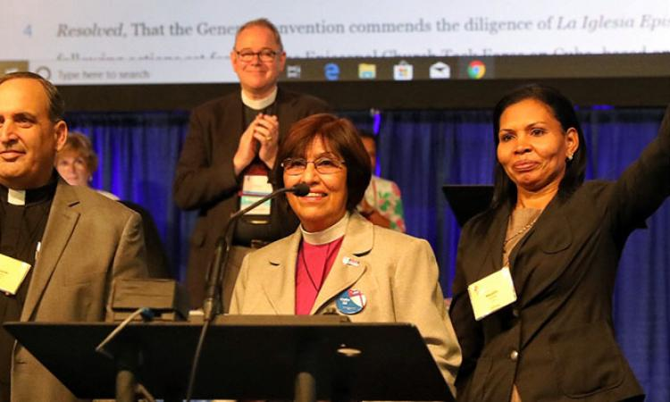 The deputation of the newly restored Episcopal Diocese of Cuba is applauded in the House of Deputies. CYNTHIA BLACK PHOTO