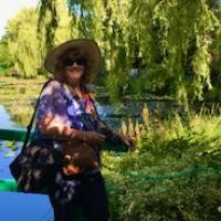 Celebrating by Debra Cook. This shows her celebrating her 60th birthday in Monet's Garden, Giverny, France.
