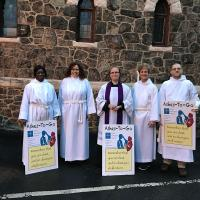 The Rev. Diana Wilcox (center) led the team from Christ Church, Bloomfield/Glen Ridge who offered Ashes to Go at the local train and bus stations. PHOTO COURTESY DIANA WILCOX