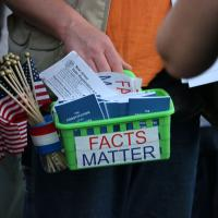 ELIZABETH: One attendee handed out American flags, voter registration forms and copies of the U.S. Constitution. NINA NICHOLSON PHOTO