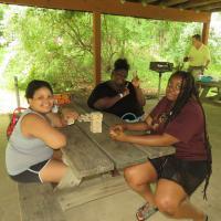 Games: Playing Jenga under the picnic pavilion before lunch. SHARON SHERIDAN HAUSMAN PHOTO