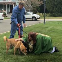 The Rev. Cathie Studwell of St. Bartholomew's, Ho-Ho-Kus blesses a dog. MARGO PECKHAM CLARK PHOTO