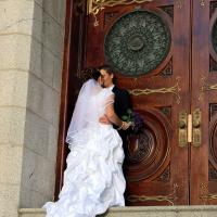 A bride and groom share a quiet moment outside Salt Lake Temple.