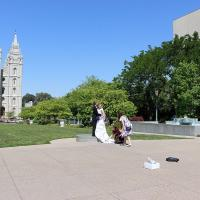 A bride and groom are photographed with Salt Lake Temple in the background.