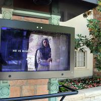 Large mounted screens continuously showed a brief video depicting Jesus