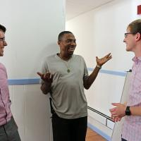Christopher Jennings and Chris Whitaker talk with Tommy Lovett (center), House of Prayer's sexton. Lovett helped facilitate the renovation of the classroom space, and plans to be in the first group of students. NINA NICHOLSON PHOTO