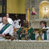 Presiding Bishop Michael Curry celebrates the Eucharist at St. Paul's, Paterson, assisted by the Rev. Deacon Erik G. Soldwedel and the Rev. Dr. Beth Faulk Glover. SHARON SHERIDAN PHOTO