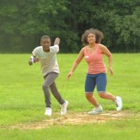 Kick ball: Youngsters run off some energy after the bus ride with a game of kick ball. SHARON SHERIDAN HAUSMAN PHOTO
