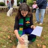 The Rev. Bowie Snodgrass of Christ Church, Short Hills blessing a dog. SARAH ROSEN PHOTO
