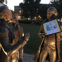 MORRISTOWN: Julie Crawford of Messiah, Chester created a poignant image by positioning her Lights for Liberty poster in the hands of a statue of General George Washington. JULIE CRAWFORD PHOTO