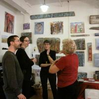 The Rev. C. Melissa Hall, second from right, and her partner, Fran Lapinski, right, talk with visitors to her River Bones Collection, which she displayed as part of the Hoboken Artists Studio Tour in November, 2013.