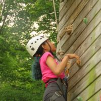 Rock climbing: Crossroads counselors guide climbers at the rock wall, beginning with safety instructions. SHARON SHERIDAN HAUSMAN PHOTO