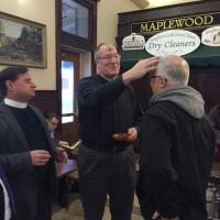 The Rev. Bernie Poppe and the Rev. Deacon Ken Boccino of St. George's, Maplewood at the Maplewood Train Station. MARTHA GARDNER PHOTO