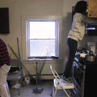 Volunteers clean The Lighthouse's kitchen.