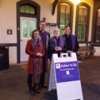 The Rev. Michael Allen of Trinity, Allendale (second from right) with Methodist, Lutheran and Presbyterian clergy at the Allendale Train Station. SHARON PIERSON PHOTO