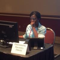 Legislative aide Dunstanette Macauley-Dukuly hard at work during the hearing.
